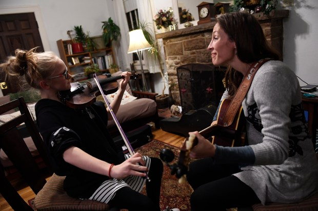 Fiddler Katie Glassman, right, has a lesson with her young student Elyssa Johnston, 11, left, her home on December 14, 2016 in Denver, Colorado. Glassman is a three-time winner of the stock show fiddle contest, teaches fiddle to young aspiring fiddlers and also plays in a band. She is helping teach younger fiddlers who will be competing at this year's Stock Show.