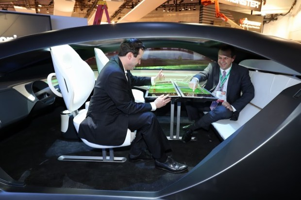 Panasonic builds the entertainment inside concept cars, like this one at its CES 2017 booth. Passengers can face each other and use a table as a monitor.