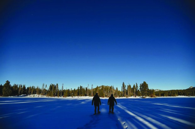 Barb Boyer Buck and Michelle Taylor making new tracks as they snowshoe across Sprague Lake late in the afternoon in the Rocky Mountain National Park January 23, 2015.
