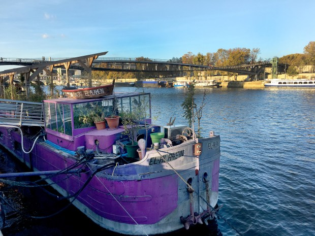 """Docked in the 13th arrondissement, the """"El-Alamein"""" is a houseboat that's been converted into a restaurant and a concert venue on the Seine."""
