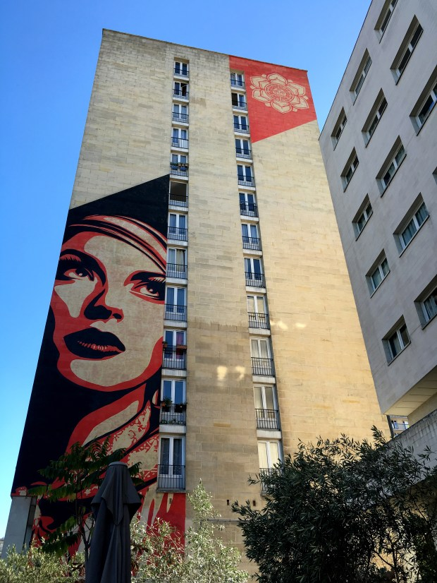 """American artist Shepard Fairey, famed for his """"Hope"""" portrait of then-candidate Barack Obama, has created three murals in the 13th arrondissement, including this one at 93 rue Jeanne d'Arc, completed in June 2012."""