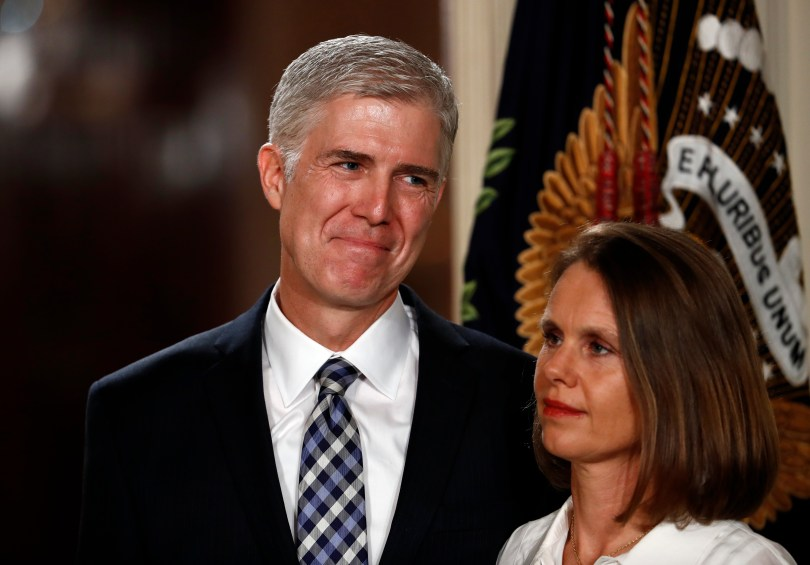 Neil Gorsuch stands with his wife Louise.