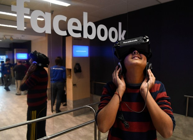 Aric Rawal, 12, tries the Facebook Virtual Reality experience at Denver International Airport January 05, 2017.