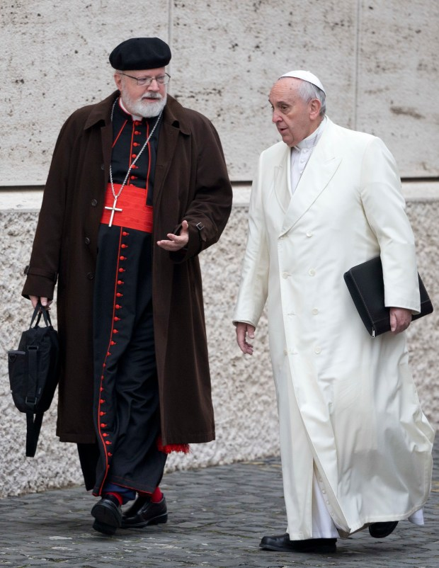 In this Feb. 13, 2015 file photo, Pope Francis, right, talks with the head of a sex abuse advisory commission, Cardinal Sean Patrick O'Malley, of Boston, as they arrive for a special consistory in the Synod hall at the Vatican.