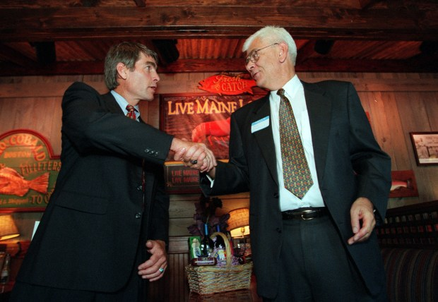 Mark Udall, Democrat, left, and Bob Greenlee, Republican, candidates for 2nd congressional district, shake hands each other after their debating in Northglenn on Sept. 1, 1998.