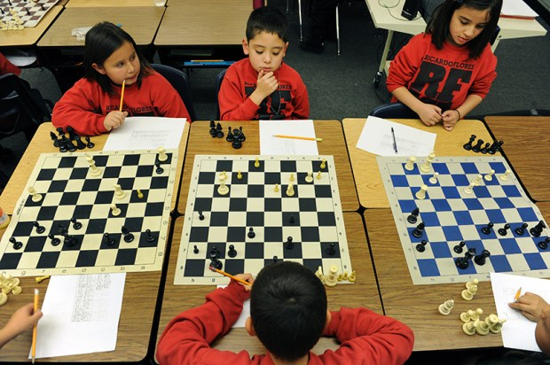 Students play chess at the Ricardo Flores Magon Academy, a charter school in Denver. The majority of Colorado school districts do not equally share local tax revenue raised through mill-levy overrides with their charter public school students.