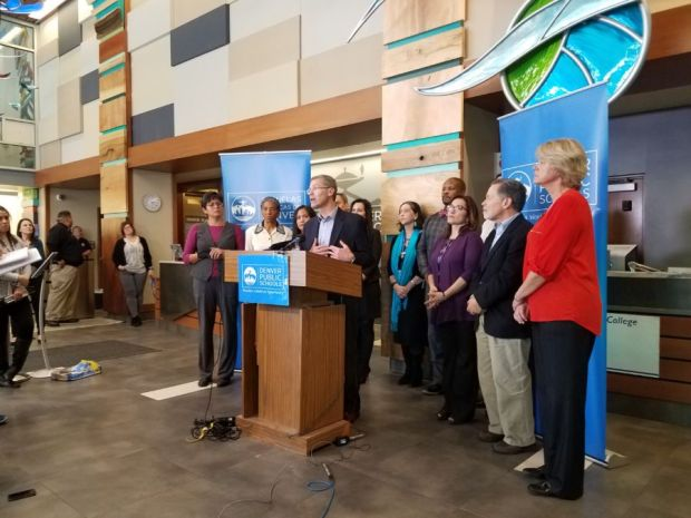 DPS Superintendent Tom Boasberg, school board members and others at Thursday's news conference.