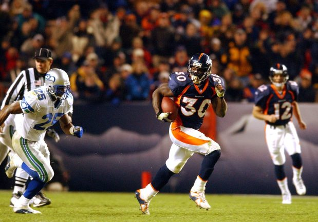Denver Broncos Terrell Davis looks back at Seahawks defender #25 Reggie Tongue as he sprints for 57 yards on a hand off by Gus Frerotte in the third quarter.