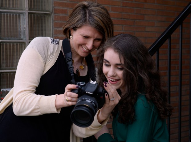 LITTLETON, CO - JANUARY 31: Kate shows her photos of her professional acting head-shots to her client, Regan Fenske, 15. Business profile of Kate Schwindt Photography. (Photo by Kathryn Scott/The Denver Post)