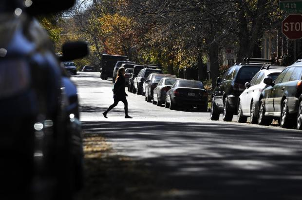 Parked cars line the road on Lafayette Street in central Denver in 2013. The area, near Capitol Hill, is densely populated with residential houses and apartments.