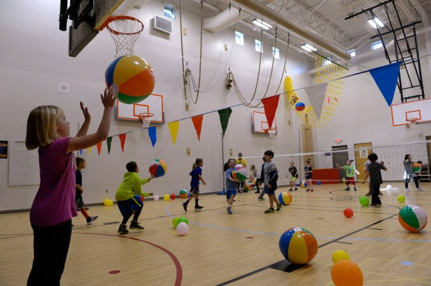 LITTLETON, CO - FEBRUARY 22: Second-graders use the newly renovated gym at Runyon Elementary School on February 22, 2017 in Littleton, Colorado. Littleton Public School put thousands of dollars into renovating Runyon Elementary School, including adding a new roof. The district views it as a model project for how to preserve an old building for the future instead of starting over. (Photo by Kathryn Scott/The Denver Post)