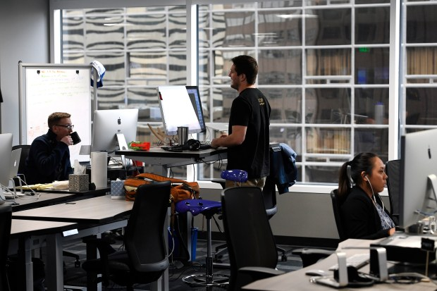 Employees work near large windows at the headquarters of SendGrid at 1801 California St. in Denver, Colorado, Feb. 1, 2017. SendGrid is a transactional email delivery and management company that provides cloud-based services for clients. The space was designed by Hampton Architecture and intentionally had desks close to windows to make for a more enjoyable working space.