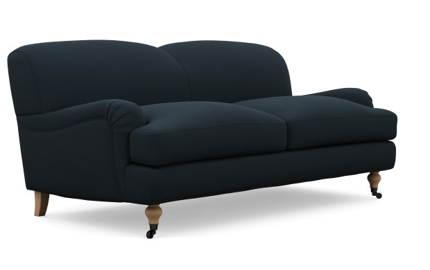 The Rose apartment sofa from Interior Define is good for someone with a small space and traditional taste ($1,200, interiordefine.com). The English roll arm style makes it warmer than most of the urban-modern small-space sofas out there.