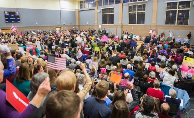 "A standing-room-only crowd fills the gymnasium of Byers Middle School during an ""in absentia"" town hall meeting directed at U.S. Sen. Cory Gardner, who was invited to attend but did not respond to the invitation on Feb. 24, 2017."