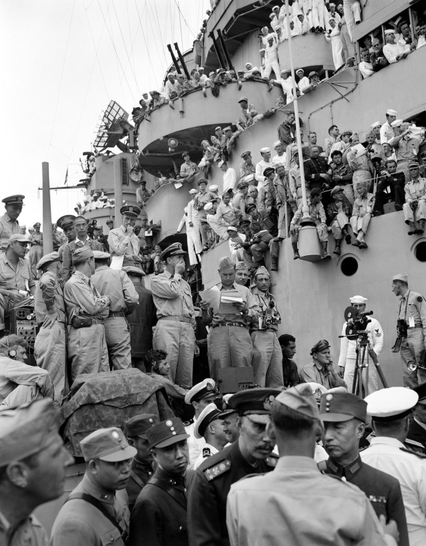 September 2, 1945: Spectators and correspondents from all over the world pick vantage positions on the deck of the USS Missouri, in Tokyo Bay to watch the formal Japanese surrender ceremony marking the end of World War II.