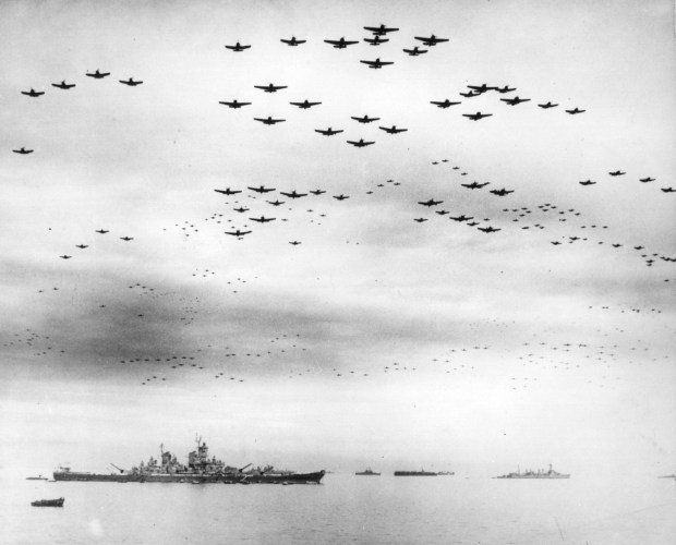 September 2, 1945: F4U and F6F fighter planes are flying in formation over the USS Missouri, while the surrender ceremonies to end World War II take place aboard the U.S. Navy battleship.