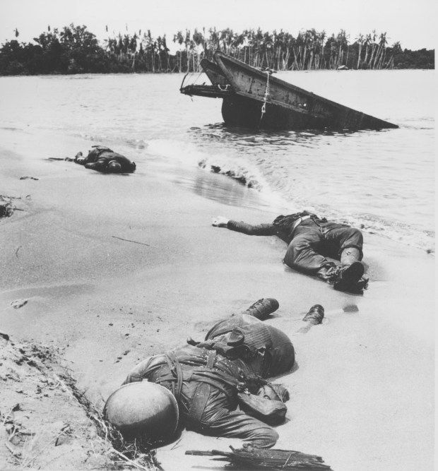 January 1943: The bodies of three American soldiers, fallen in the battle for Buna and Gona, lie on the beach of the island in the Papua New Guinea region during World War II.