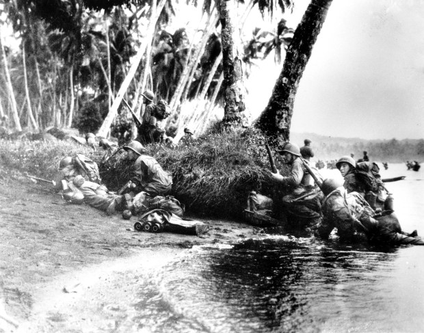 Aug. 1942: U.S. Marines approach the Japanese occupied Guadalcanal in the Solomon Islands during World War II.