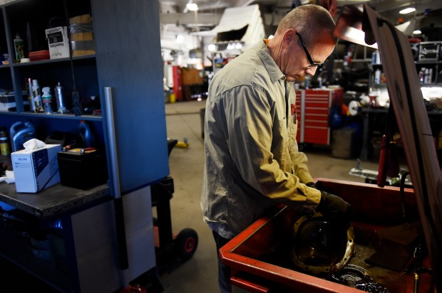 LAKEWOOD, CO - FEBRUARY 7: Scott Millsapps works on the rear pinion seal of a fleet truck at Lakewood Fleet Maintenance in Lakewood, Colorado on February 7, 2017. LakewoodÕs fleet maintenance division recently received new certification. (Photo by Seth McConnell/The Denver Post)