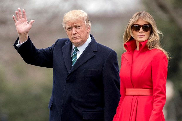 President Donald Trump and first lady Melania Trump wave to members of the media they walk on the South Lawn of the White House on March 17.