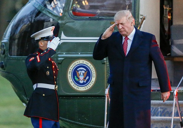 President Donald J. Trump salutes as he disembarks Marine One on the South Lawn of the White House on Sunday.