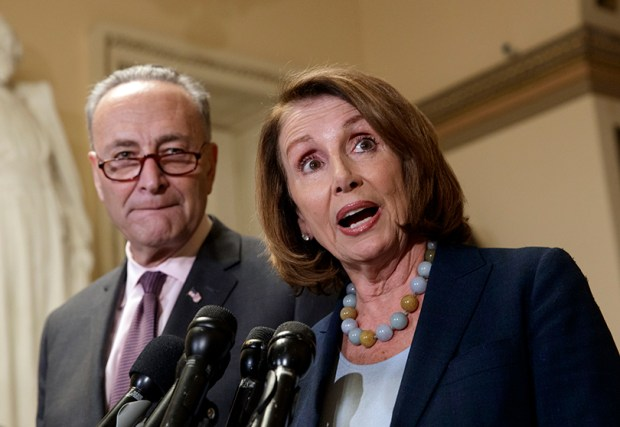 House Minority Leader Nancy Pelosi and Senate Minority Leader Chuck Schumer speak to reporters earlier this month about the Congressional Budget Office projection that 14 million people would lose health coverage under the House Republicans' health care bill.