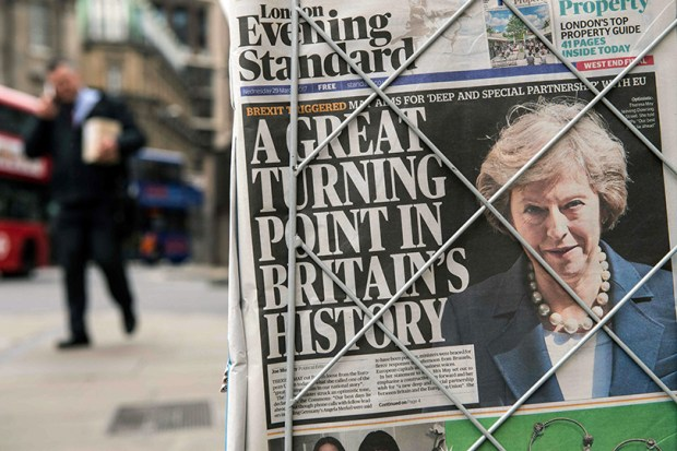 A newspaper stand in London shows a copy of Wednesday's Evening Standard, with the front-page story relating to British Prime Minister Theresa May's triggering of Article 50 of the Lisbon Treaty to begin the process of Britain's withdrawal from the European Union.