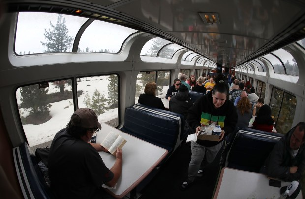 People enjoy the view from Amtrak's ...