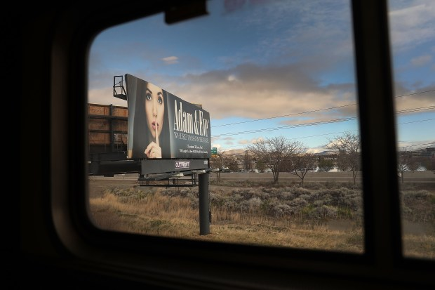 A billboard is seen as Amtrak's ...