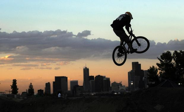 Clifton Dodge, 25, catches air while trying out the new Trestle Bike Skills Course at Barnum Park North in Denver in August 2011.