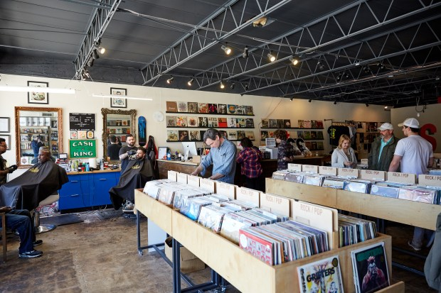 Seasick Records is home to about 8,000 vinyl LPs, as well as Newman's Classic Cuts barbershop.