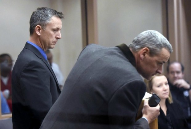 Dylan Hollingsworth, left, and defense attorney Jon Banashek appear in front of the judge during a court hearing in December at the Boulder County Jail.