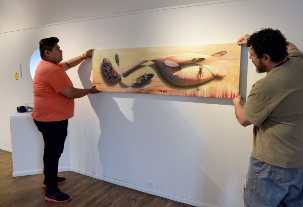 Metro State University art student Lee Waldman, right, and gallery staffer Giovanni Cantor prepare for the upcoming exhibit at Emmanuel-Shearith Israel Chapel on the Auraria Campus on March 6 in Denver.