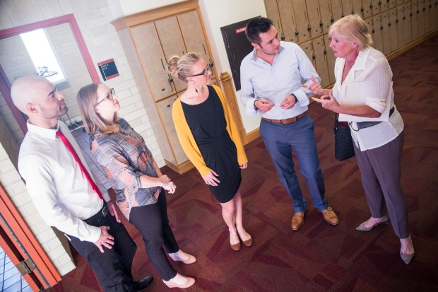 "Colorado State University Global Social and Sustainable Enterprise MBA students, from left to right, Montana Williams, Hannah Holden, Meghan King, and Charlie Warden talk with Susan Morrice, one of the judges who awarded their team ""Business for Good"" the $10,000 first place prize during the DisCOver Challenge business design competition at Denver University on Saturday."