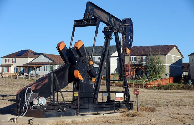 An oil pump jack operates in Frederick. The head of the Colorado Department of Public Health and Environment recently cast doubt on a research study claiming a link between oil and gas operations and leukemia.