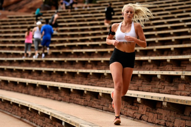 A woman runs at Red Rocks Amphitheatre