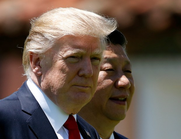 President Donald Trump and Chinese President Xi Jinping walk together at Mar-a-Lago resort in Palm Beach, Fla., on April 7. The U.S. is pressuring Beijing to use its clout with North Korea to rein in its nuclear and missile programs.