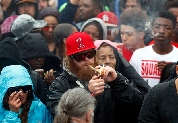 Marijuana enthusiasts light up at 4:20 p.m. on April 20 at Denver's Civic Center.