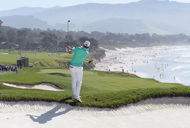Brandt Snedeker hits a shot from the rough on the ninth hole of the Pebble Beach Golf Links in Pebble Beach, Calif., during a tournament on Feb. 15, 2015. In 1958, members of the public could play Pebble Beach for $8; today it's a minimum of $1,835.