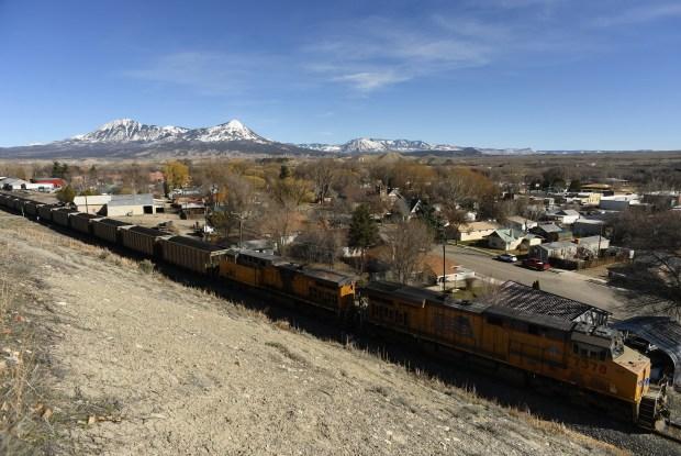 A coal train makes its way ...