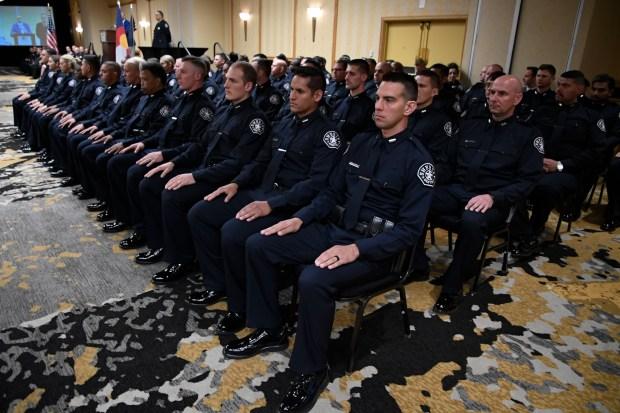 The 2016 class sit in uniform ...