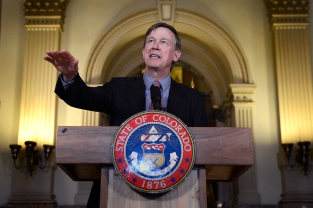 "Gov. John Hickenlooper address the crowd during a press conference at the capitol in Denver May 21, 2013. Hickenlooper issued an executive order granting convicted killer Nathan Dunlap a ""temporary reprieve"" from an execution that had been just three months away."