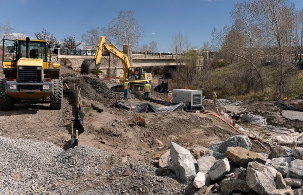 Construction crews continue their work on Festival Park, including the construction of the new performance pavilion, on April 19 in Castle Rock.