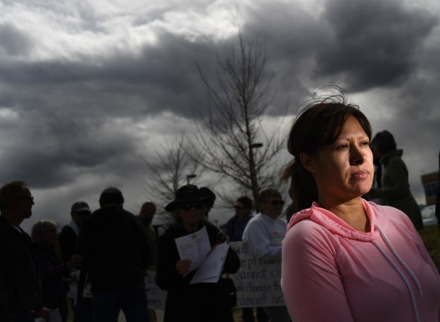 Ana Sauzameda, wife of Arturo Hernandez Garcia, and others call for his release outside the Immigration and Customs Enforcement processing center in Centennial last Wednesday.