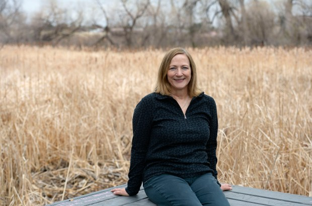 Joyce Bradney sits on a bench inside the Jewell Wetlands Park on March 28 in Aurora.