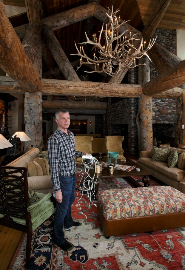 Quark founder Tim Gill stands in his Aspen home.
