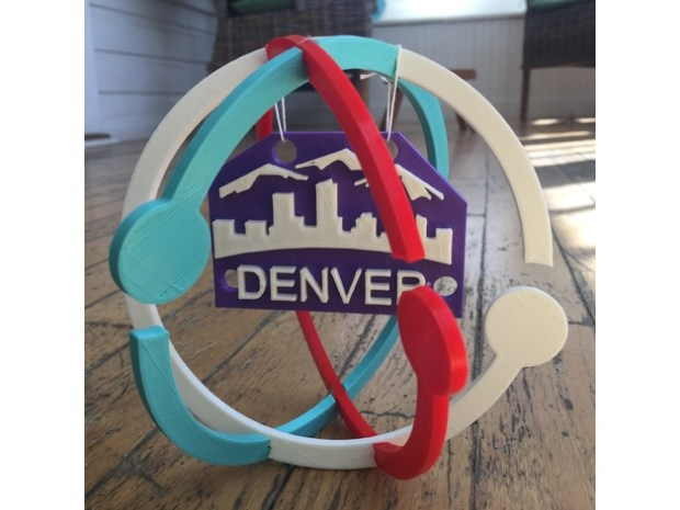 A photo of a 3-D printed logo for the March for Science Denver