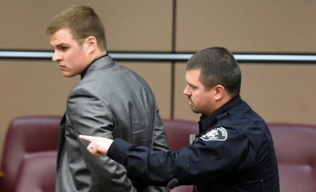 Kyle Couch, 21, in taken into custody in a Boulder courtroom Tuesday after being sentenced in the death of 8-year-old Peyton Knowlton in a traffic crash in Longmont last year.
