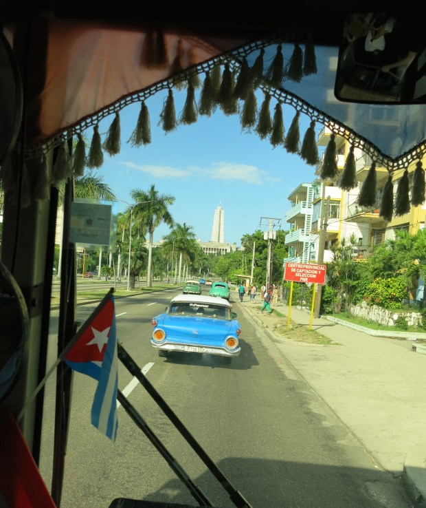 The view through the windshield of a city bus in Havana, Cuba. Transportation on a public bus costs only pennies per person.