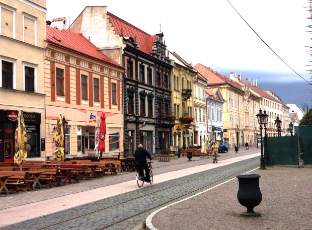 Early-morning bikers on Kosice's main street, Hlavna Ulica. The cafe terraces that line the street are bustling most other times of the day.